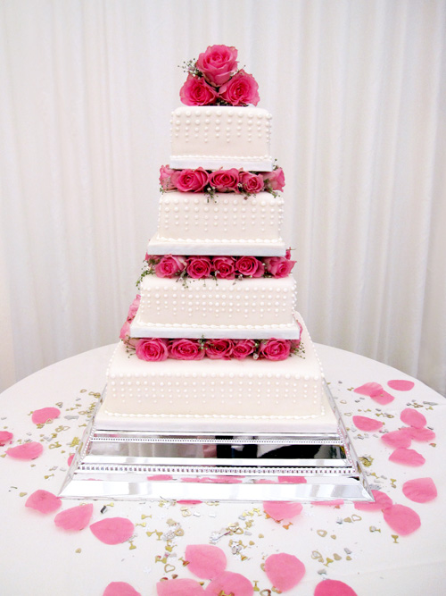 4 Tier Cake with Pink Roses and Pearl Icing