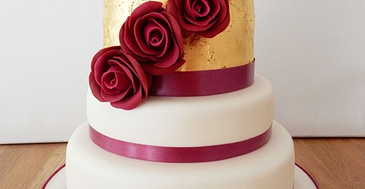 Wedding Cake with Gold Leaf and Red Roses