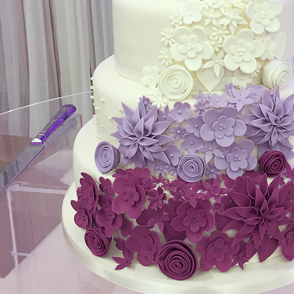 5 Tier Cake with Purple Cascading Flowers - Close up of the intricate floral design