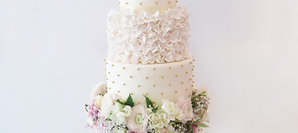 5 Tier Quilted and Ruffle Wedding Cake with Pastel Flowers