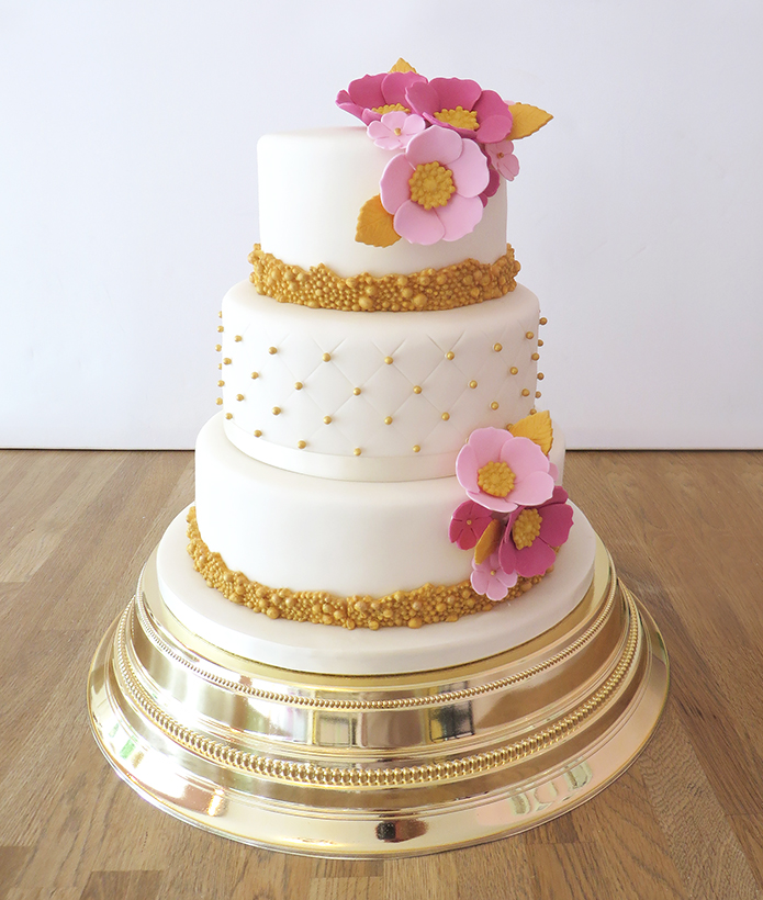 Wedding Cake with Gold Beading and PInk Flowers