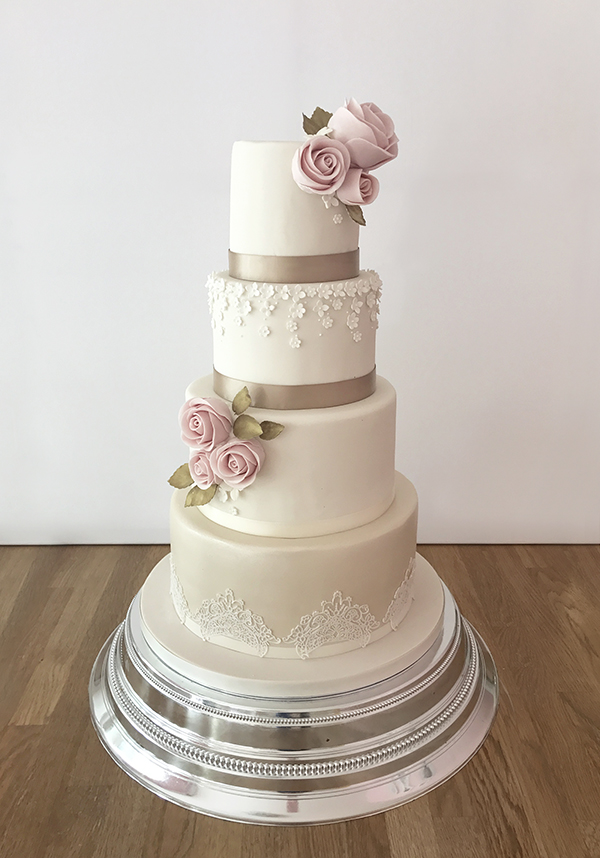Wedding Cake With Delicate Flower And Lace Details The