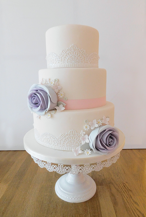 Wedding Cake with White Lace and Large Roses