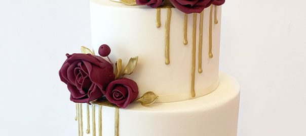 Gold and Ivory Drippy Wedding Cake with Burgandy Roses