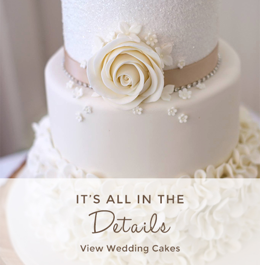 Floral details on a beautiful ivory wedding cake