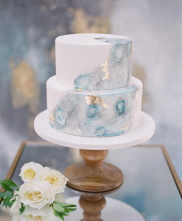 Pretty blue and gold marble effect wedding cake