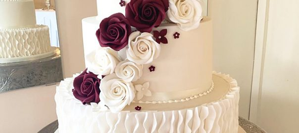 Wedding Cake with Ruffles and Burgandy Flowers