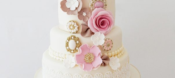 4 Tier Wedding Cake with Pink Flowers and Brooches