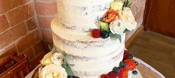 Naked Wedding Cake with Fresh Fruit and Flowers