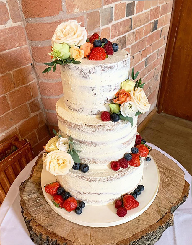 Naked Wedding Cake with Fresh Fruit and Flowers