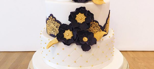 Asian Wedding Cake with Black and Gold Flowers