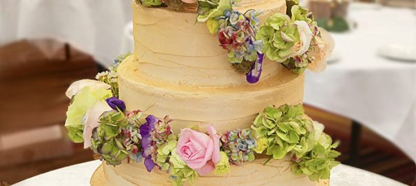 Semi-Naked Cake with Fresh Pastel and Purple Flowers