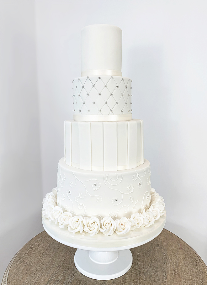 4 Tier Ivory Wedding Cake with Patterns