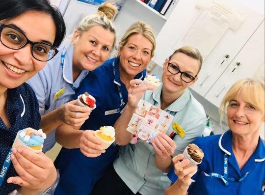 Nurses smiling with cupcakes from The Cakery