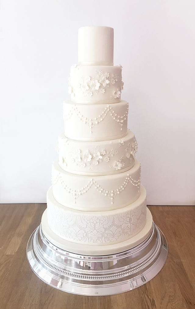 6 Tier Ivory Wedding Cake with Pretty Details