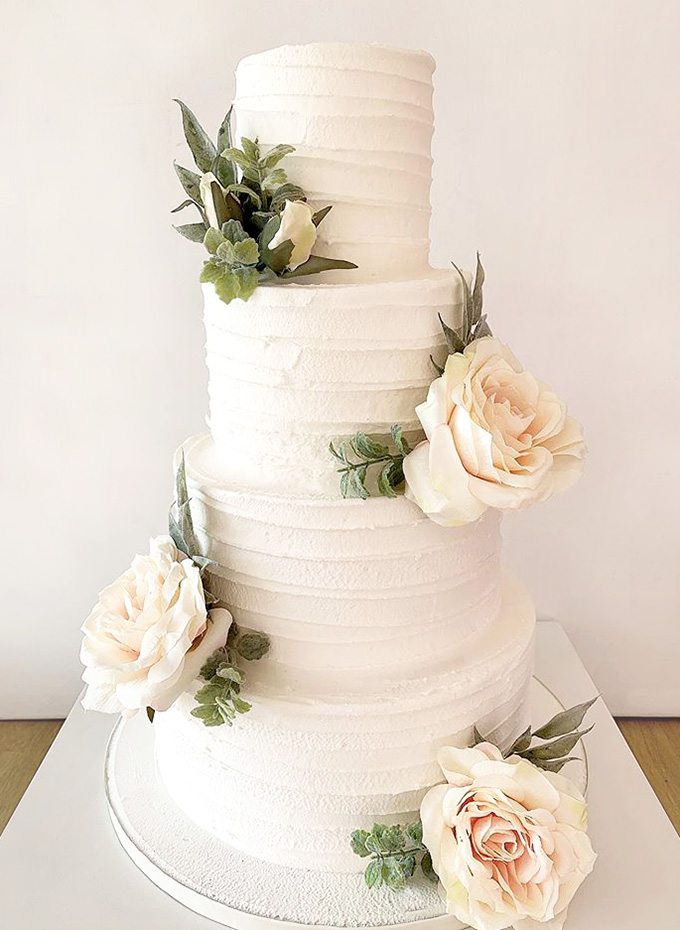 Scalloped Wedding Cake with Greenery