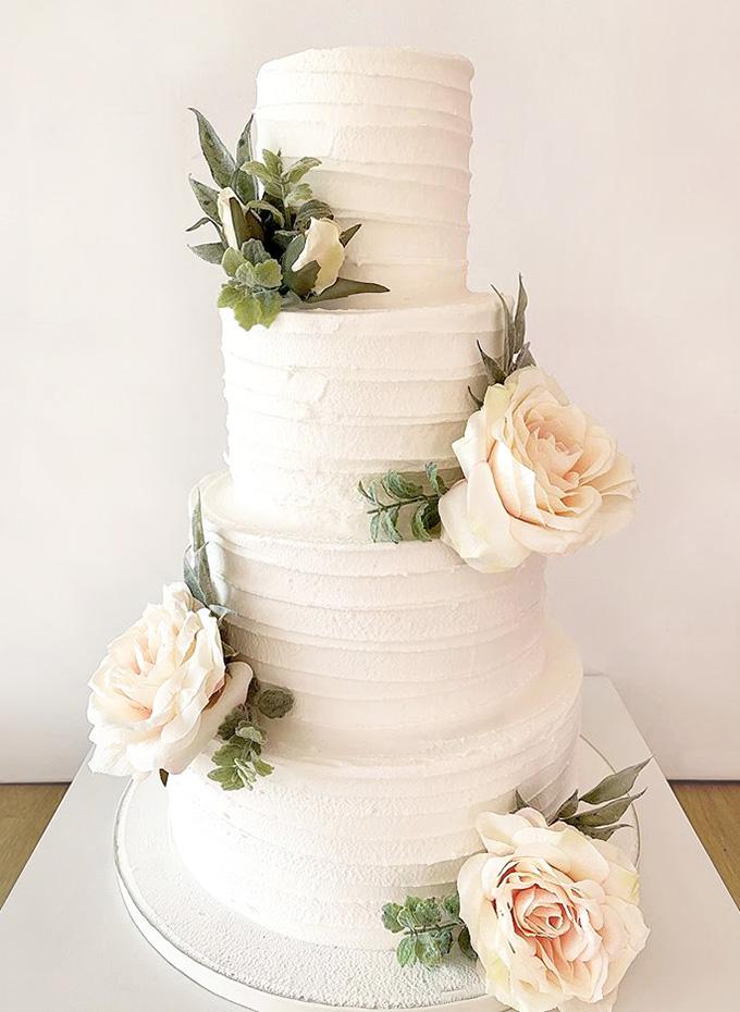 Scalloped Wedding Cake with Greenery