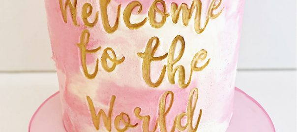 Welcome to the World Pink and Gold Cake