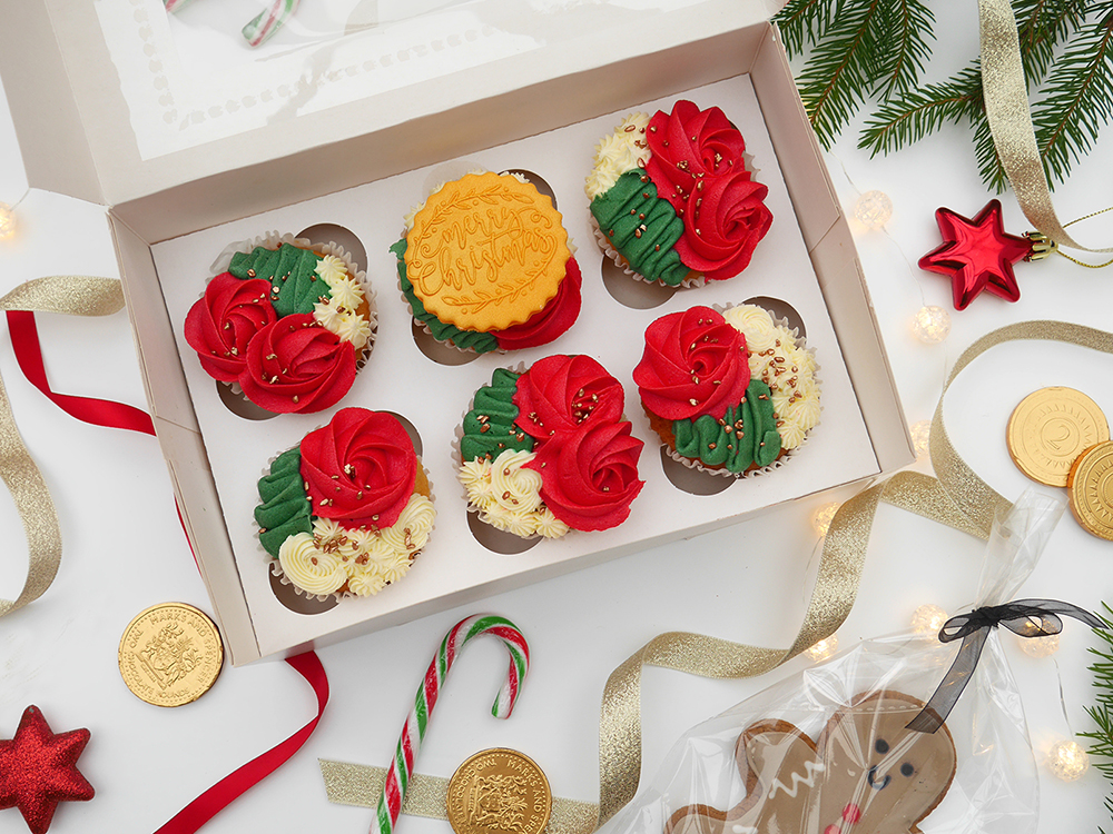 A box of 6 Christmas cupcakes in ivory, red, green and gold.