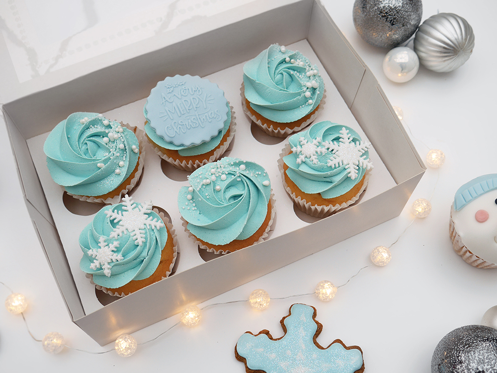 Box of 6 pastel blue cupcakes with snowflake decoration