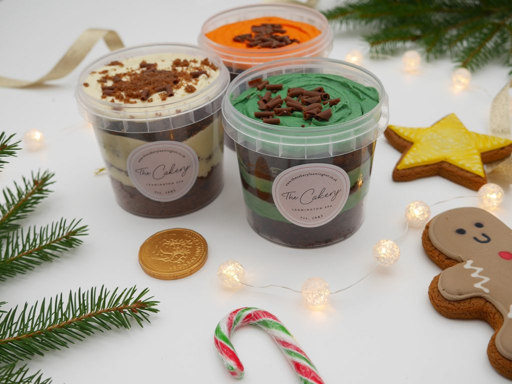 A set of 3 Christmas cake tubs in festive flavours.