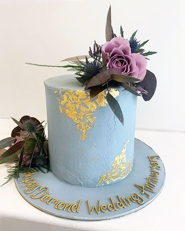 Blue Buttercream Cake with Gold Leaf and Flowers