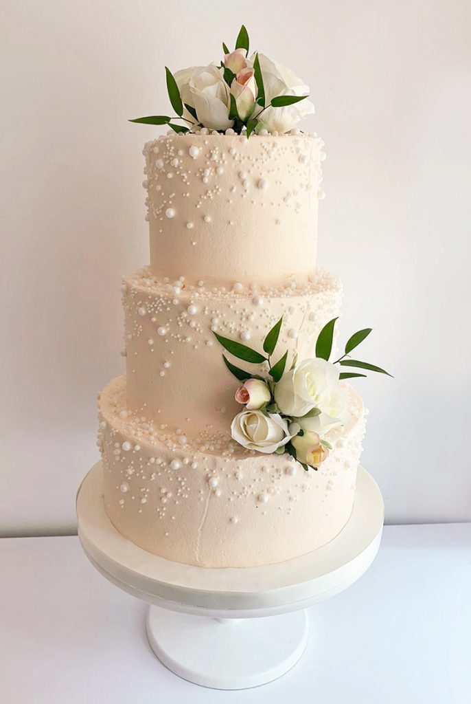 Buttercream Wedding Cake with Pearls and Roses