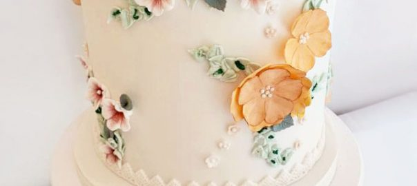 Floral Wedding Cake in Orange Peach and Pink
