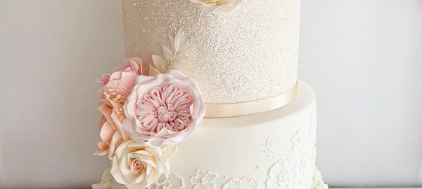 Sparkly Ivory Wedding Cake with Pink and Peach Flower Details 1